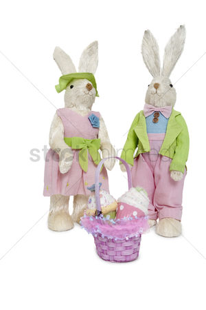 Animal : Portrait of stuffed rabbit couple standing together with basket over white background