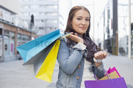 Shopping : Portrait of woman carrying shopping bags