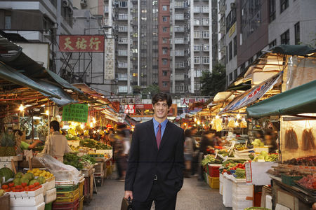 Shopping background : Portrait of young business man at street market