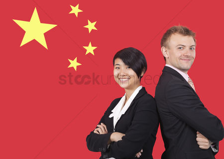 Respect : Portrait of young businesswoman and man smiling over chinese flag