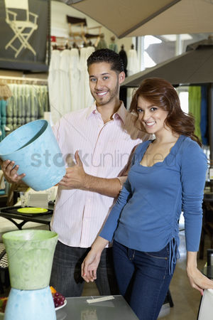 Supermarket : Portrait of young couple with a souvenir in store
