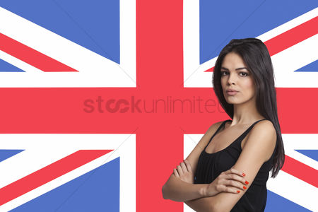 British ethnicity : Portrait of young woman against british flag