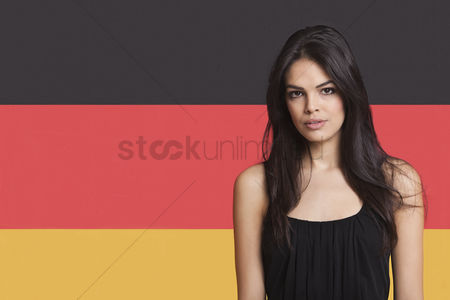 Respect : Portrait of young woman against german flag