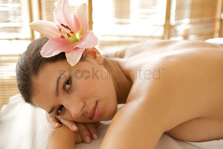 Body : Portrait of young woman relaxing on massage table