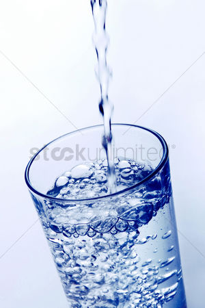 Refreshment : Pouring water into a glass