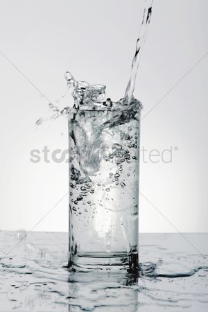Cold temperature : Pouring water into drinking glass with ice
