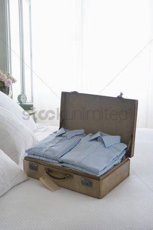 Obsessive : Pressed shirts in a suitcase