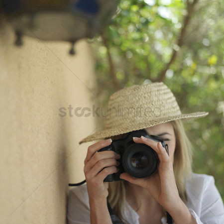 Alone : Professional female photographer taking picture