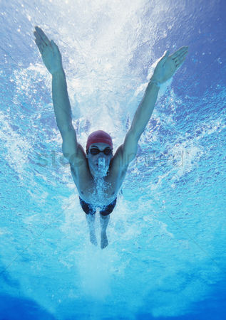 Swimmer : Professional young male athlete swimming in pool
