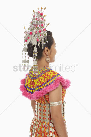 Bidayuh ethnicity : Rear view shot of a woman in an iban traditional clothing