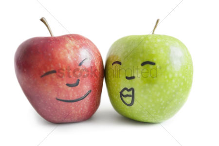 Variety : Red and green apples with face over white background