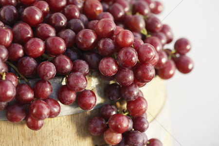 Grapes : Red grapes arranged on wine cask close-up