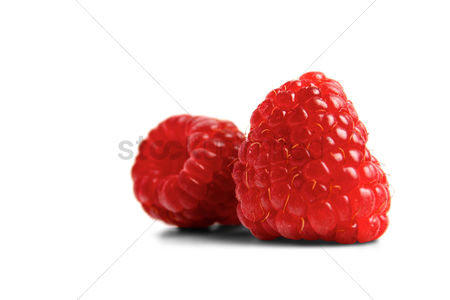 Refreshment : Red raspberries on white backgroud