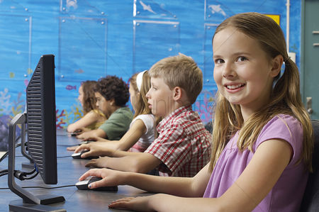 School : School children using computers in classroom
