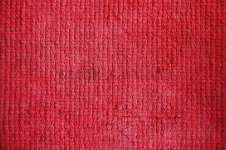 Texture : Seam of a red woolen fabric