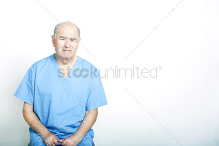 Frowning : Senior adult patient looking very upset