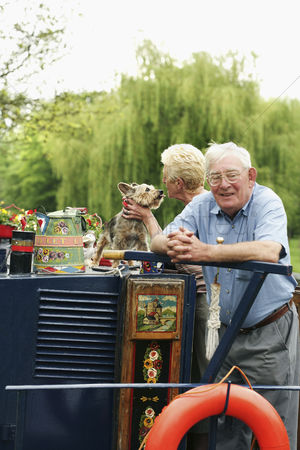 Houseboat : Senior couple and their pet dog on the houseboat