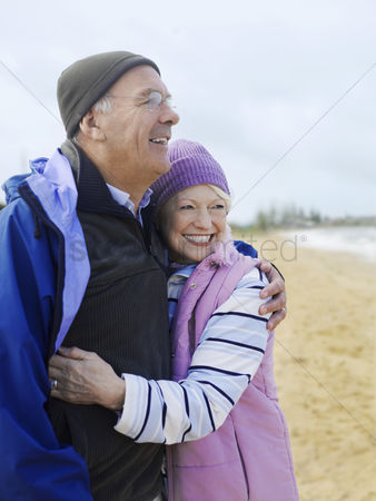 Jacket : Senior couple embracing outdoors