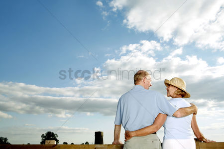 Lady : Senior couple enjoying the beautiful view together
