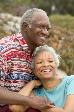 Senior women : Senior couple relaxing outdoors smiling