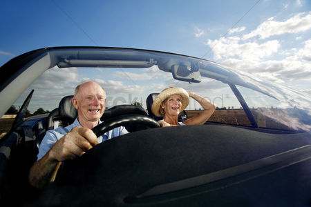 Smiling : Senior couple traveling in the car