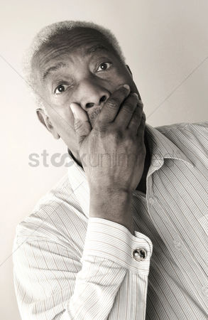 Loss : Senior man in shock covering his mouth