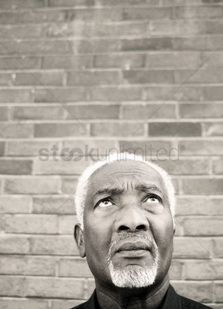 Aging process : Senior man looking up