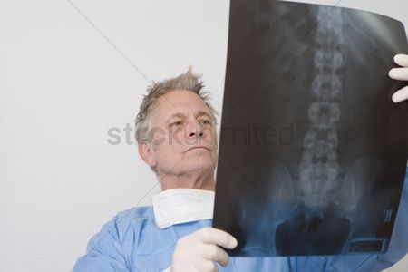 Medical : Senior medical practitioner stands with xray