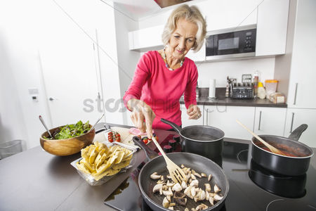 Bowl : Senior woman cooking food in kitchen