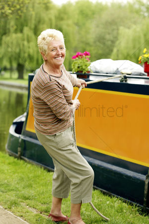 Houseboat : Senior woman pulling houseboat