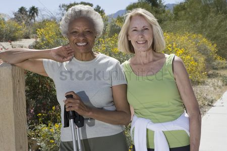 Senior women : Senior women stand with walking poles