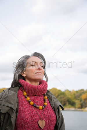 Bliss : Serene looking mature woman