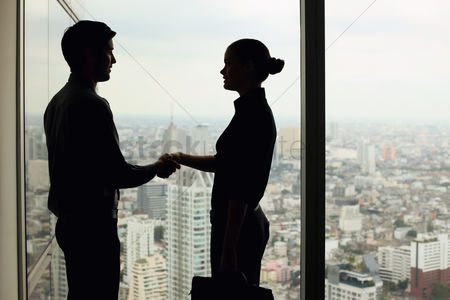 Two people : Silhouette of business people shaking hands