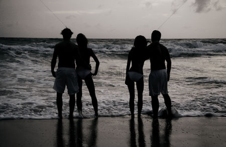 Lover : Silhouette of couples standing on the beach