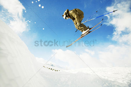Enjoying : Skier flying in the air