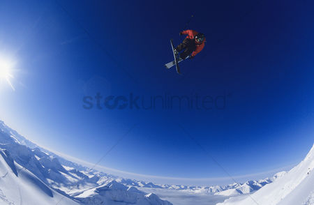 Winter : Skier jumping against blue sky