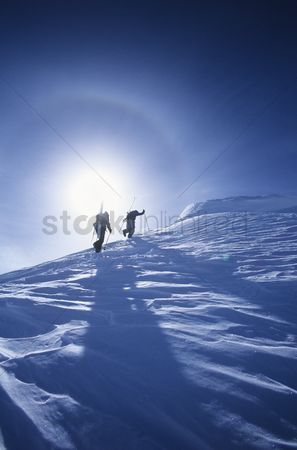 Remote : Skiers hiking to mountain summit