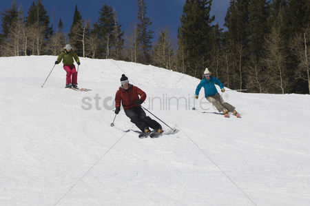 Women group outside : Skiers skiing down slope