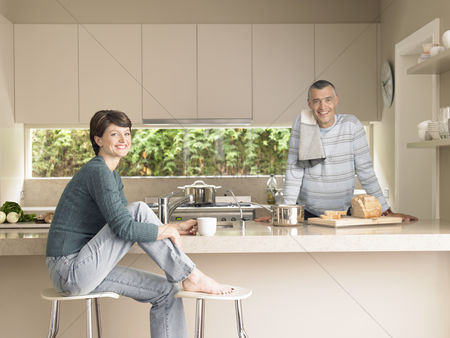 Husband : Smiling couple in kitchen  portrait