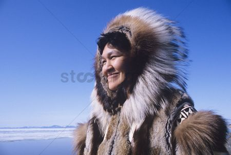 Traditional clothing : Smiling eskimo woman in traditional clothing