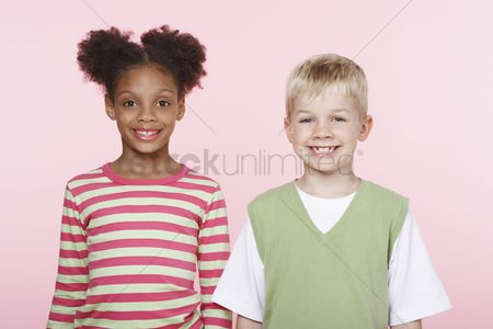 Posed : Smiling girl and boy side by side