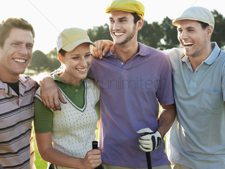 Appearance : Smiling group young golfers with arms around each other s shoulders on golf course