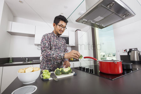 Bowl : Smiling man cooking in kitchen at home