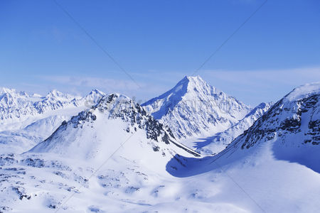 Cold : Snow-covered mountain range