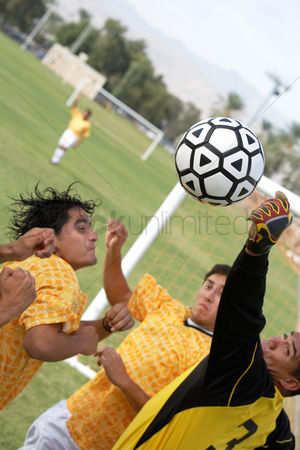 Match : Soccer players competing for ball