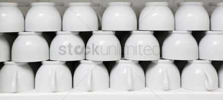 Collection : Stack of clean white coffee cups
