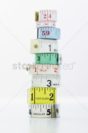 Variety : Stack of rolls of measuring tape close-up