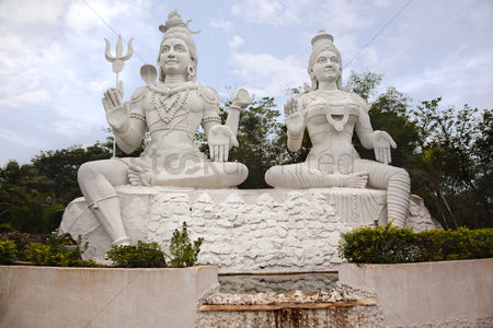 God : Statues of lord shiva and goddess parvathi  kailasagiri park  visakhapatnam  andhra pradesh  india