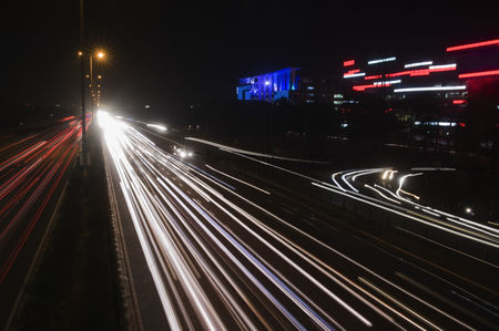 On the road : Streaks of lights of moving vehicles on the road  national highway 8  gurgaon  haryana  india