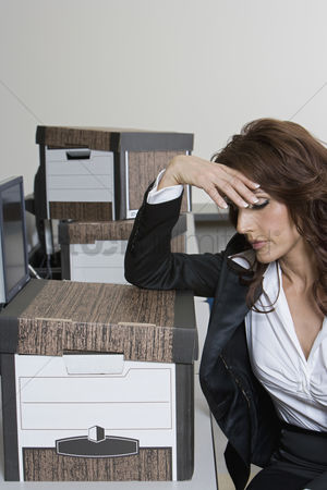 Worry : Stressed businesswoman and moving boxes